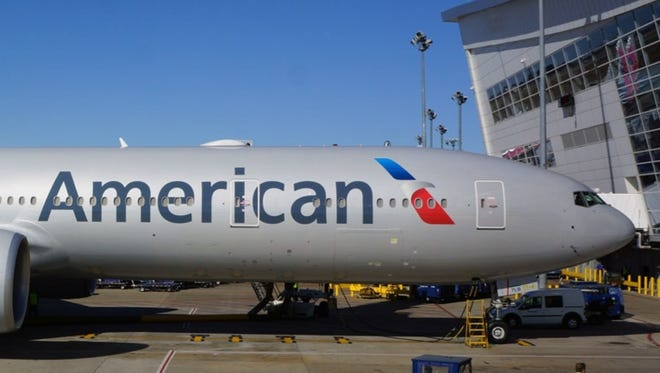 Seen here in Dallas/Fort Worth on Jan. 31, 2013,  prior to its inaugural flight to Sao Paolo, this Boeing 777-300ER was the first plane to fly paying passengers in American Airlines' new paint scheme.