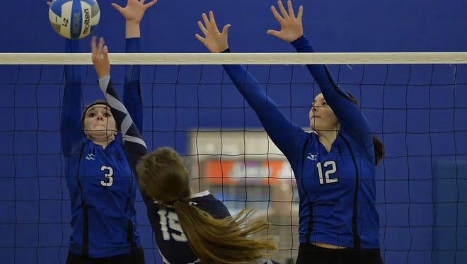 Kaely Thompson (3) and Michelle Malsch (12) are two of four returning starters on the St. Joseph's volleyball team, which enters the week with a record of 18-5-1.
