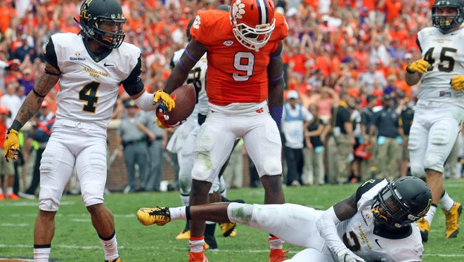 Wayne Gallman (9) reacts after bulling his way past an Appalachian State defender for a touchdown on Sept. 12.