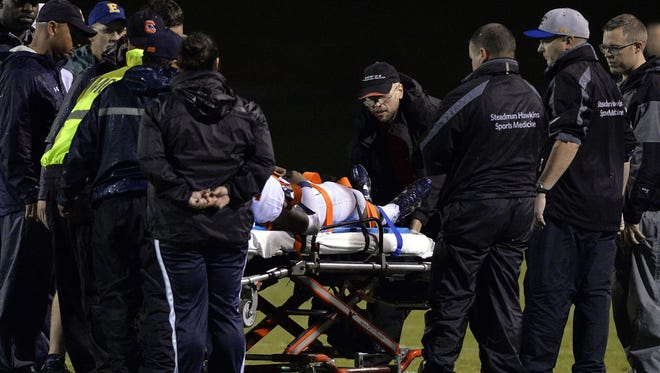 Medical personnel tend to Chapman's Patrick Phongsat during the Panthers' 31-27 loss at Eastside Friday night.