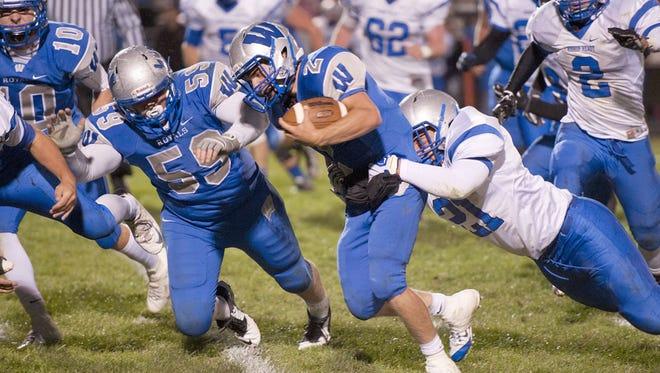 Wynford quarterback Zach Hoffman drags a Bishop Ready defender.