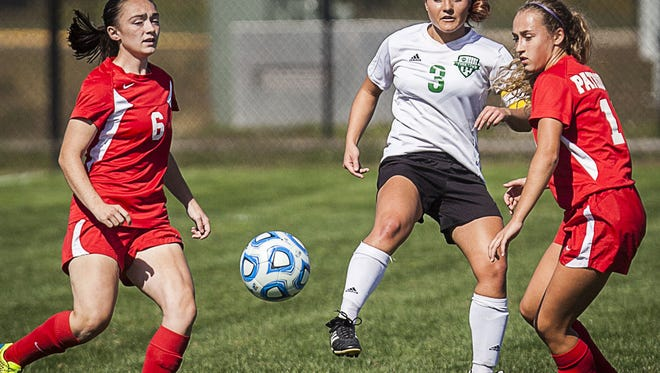 Yorktown's Sarah Bade kicks the ball in her team's 3-1 win against Jay County on Saturday, Oct. 10, 2015.
