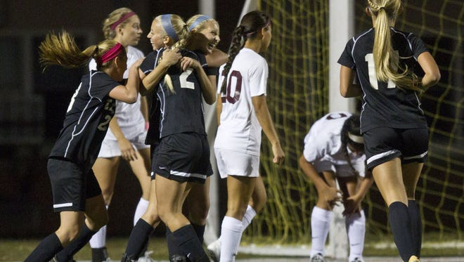 Toms River East girls soccer players celebrate after scoring a goal on Oct. 13, 2015