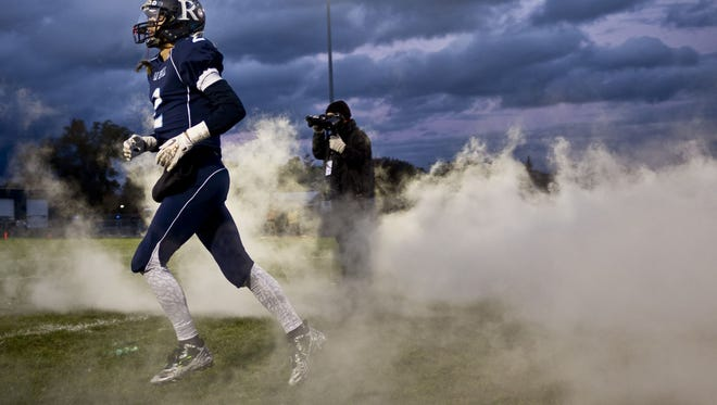 Richmond players take the field during a football game Friday, October 16, 2015 at Richmond High School.