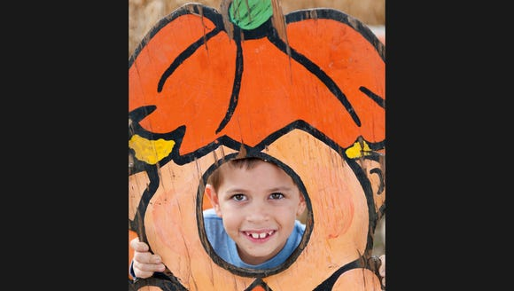 Sal Toledo, 6, of Woodlake, poses for a photo at Vossler