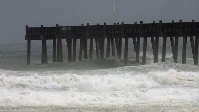 Rough surf and heavy rains whip up the seas off Pensacola Beach Monday morning Oct. 26, 2015.
