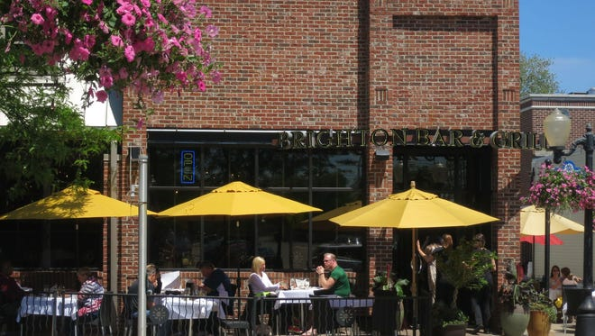 The Brighton Bar and Grill on Main Street in downtown Brighton features sidewalk seating in front and along the side of the restaurant.