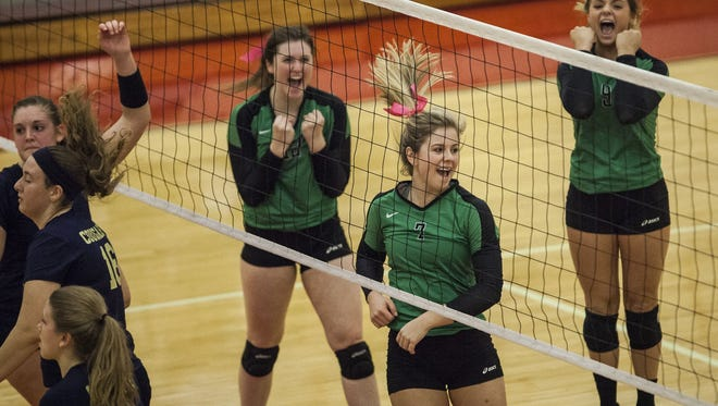 Yorktown celebrates a point against New Prairie during the first round of the Twin Lakes Semi-State Saturday afternoon. Yorktown won 3-0, then defeated Leo 3-0 to earn a spot in the state championship.