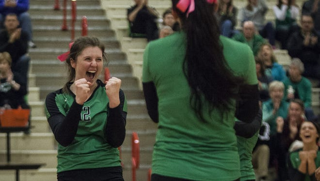 Yorktown's Mimi Arrington celebrates after a point during the Twin Lakes Semistate semifinal. Yorktown won the match 3-0.