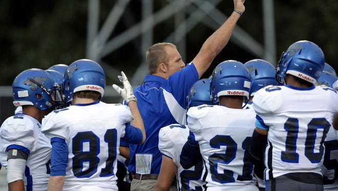 Second-year coach Ned Cuthbertson, center, and his Woodmont Wildcats will host No. 9 Hillcrest in a Region 1-AAAA game Friday night.