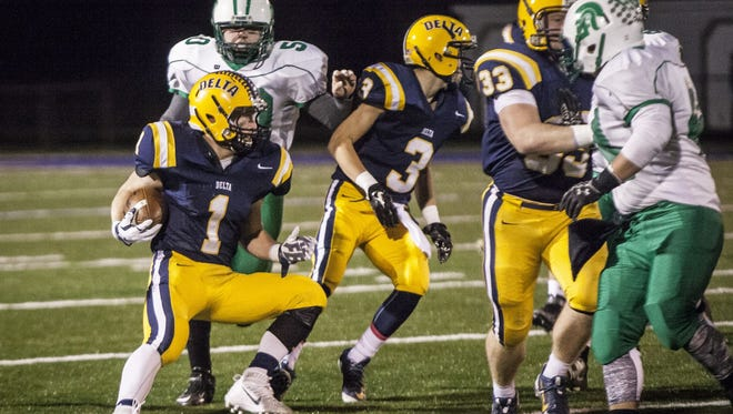 Delta's Zach Mills looks for space to run against New Castle in a 49-7 win on Oct. 30, 2015.
