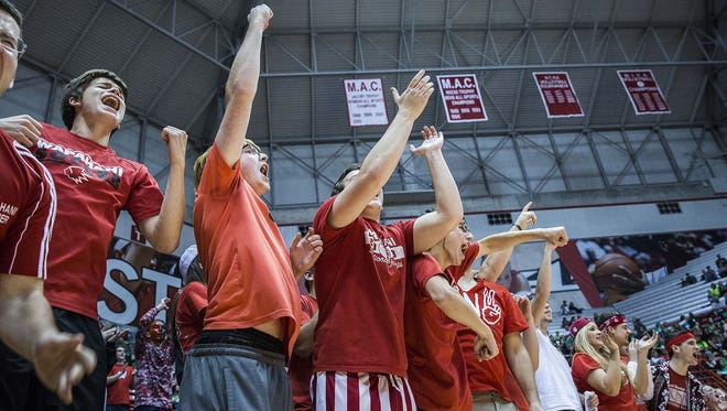 Fans cheer at Worthen Arena during the IHSAA state volleyball championships on Saturday.