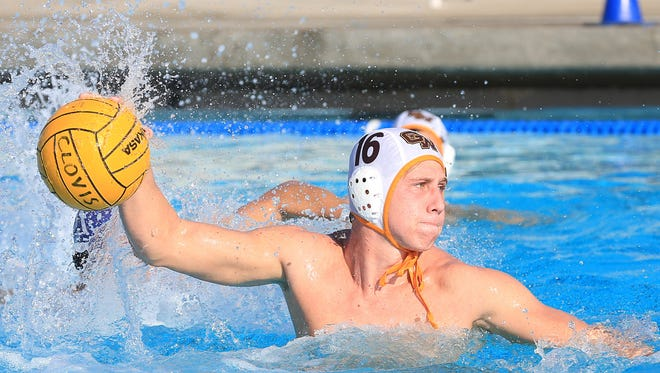 Golden West's Brad Dennis prepares to score against Clovis during the Central Section Division I Boys Water Polo Finals match on November 21, 2015.