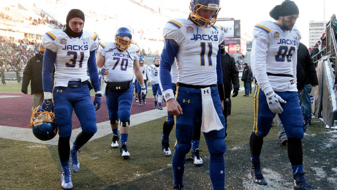 The Jacks walk off the field after their season ended in a 24-17 loss at Montana