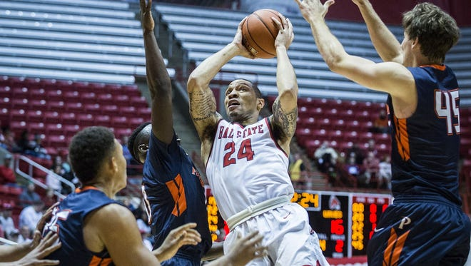 Ball State's Jeremiah Davis shoots past Pepperdine's defense during their game at Worthen Arena Saturday, Dec. 12, 2015.