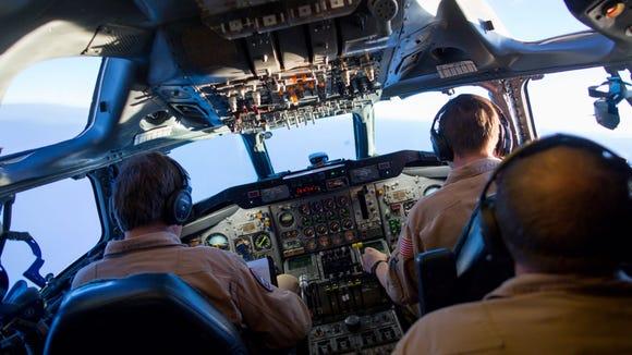 Pilots aboard NASA's Douglas DC-8 flying laboratory