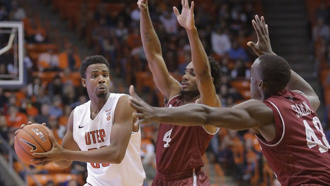 New Mexico State's Pascal Siakam, right, and Ian Baker (4) guard UTEP's Earvin Morris Saturday night at the Don Haskins Center in El Paso. The Aggies beat the Miners 73-53 to sweep the Battle of I-10 season series.