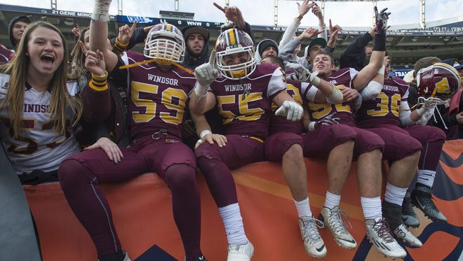 The Windsor High School football team celebrates winning the Class 4A state championship game at Sports Authority Field at Mile High Saturday, December 5, 2015.