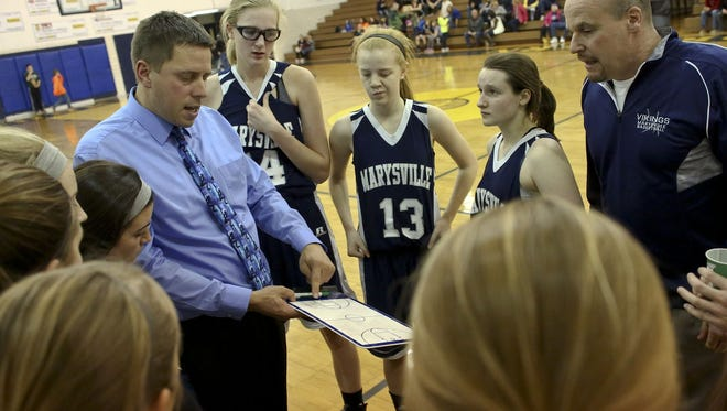 Marysville coach Ryan Rathje talks with players during a basketball game Friday, Dec. 4, 2015 at Port Huron Northern High School. Northern beat Marysville 62-43.