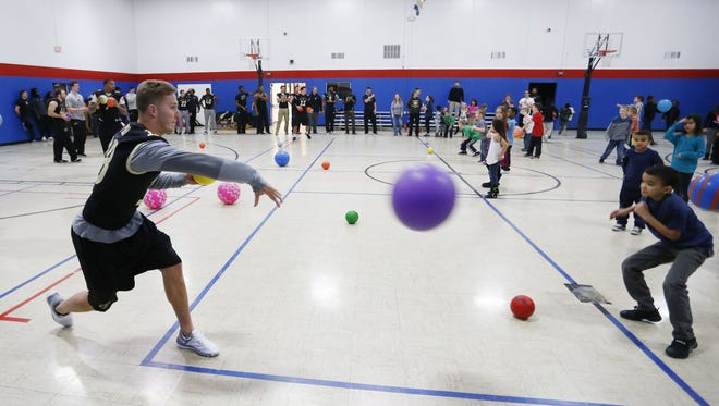 Chaos ensues as members of the Purdue University football team play dodgeball Friday, January 29, 2016, with the youngsters at Lyn Treece Boys & Girls Club, 1529 N. 10th Street in Lafayette.