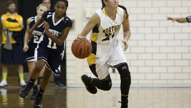 Port Huron Northern's Jenna Koppinger breaks away with the ball during a basketball game Friday, Dec. 4, 2015 at Port Huron Northern High School. Northern beat Marysville 62-43.