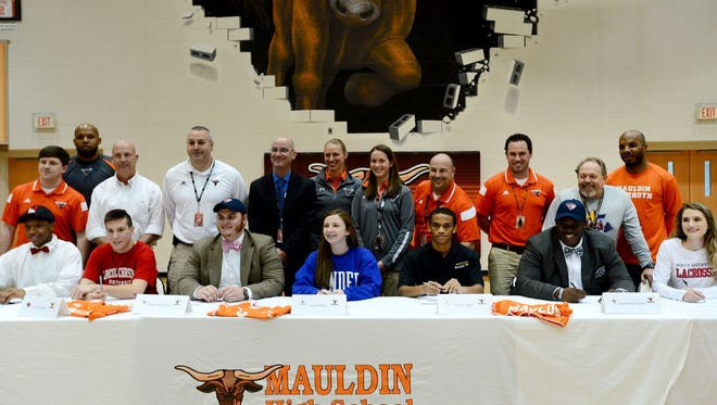Seven Mauldin High School seniors made their college choices official during a Signing Day ceremony Wednesday.
