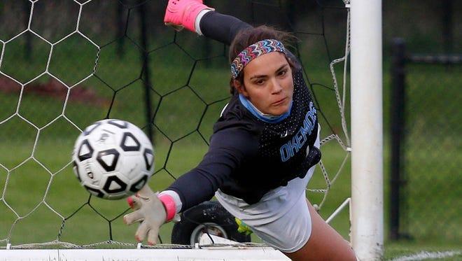 Okemos senior goalie Caroline Serkaian signed to play at Division I University of Wisconsin-Milwaukee on Wednesday.