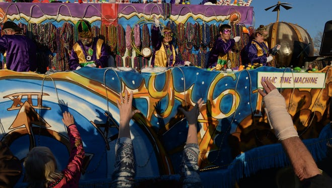 The 2016 Krewe of Gemini Parade makes its way along the Clyde Fant Parkway in Shreveport as thousands of people lined the route yelling for throws.