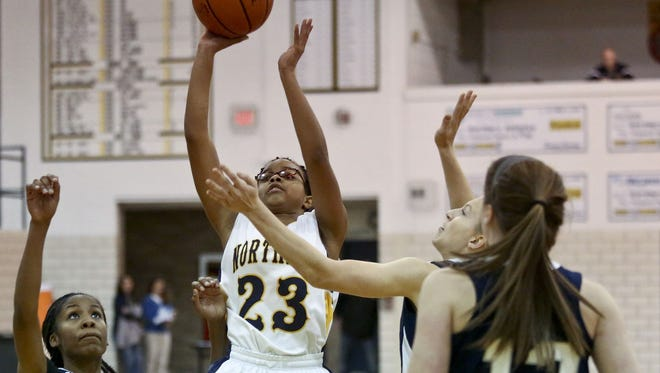 Port Huron Northern's Olivia Ramsey makes a shot over a host of Marysville defenders during a basketball game Friday, Dec. 4, 2015 at Port Huron Northern High School. Northern beat Marysville 62-43.