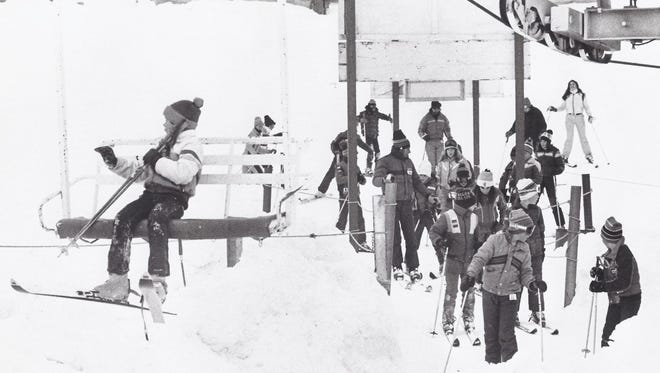 Archived photo of skiiers at Mt. Brighton.