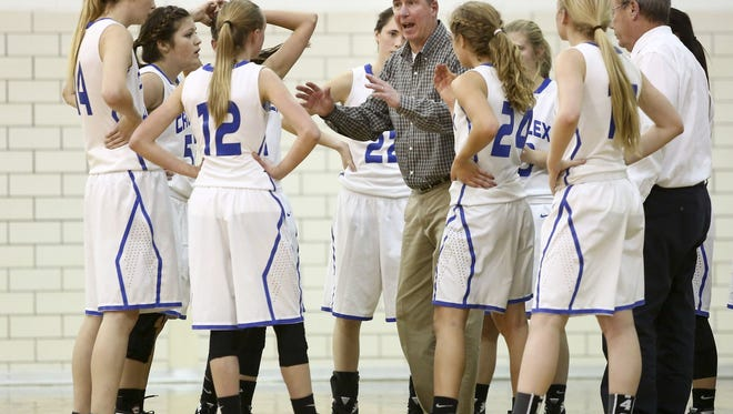 Cros-Lex coach Darren Bongard talks with players in a huddle during the Holiday Girls Basketball Tournament Tuesday, Dec. 22, 2015 at Port Huron Northern High School