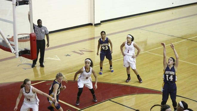 Port Huron Northern senior Kiana Votava takes a free throw during a basketball game Tuesday, Dec. 8, 2015 at Port Huron High School.