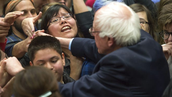 Bernie Sanders supporters push through the crowd to meet the 2016 presidential candidate following a speech at Moby Arena Sunday, February 28, 2016.