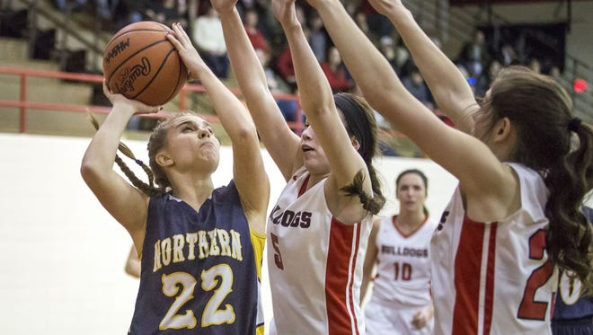 Port Huron Northern junior Brooke Austin takes a shot over several Romeo defenders during a district final basketball game Friday, March 4, 2016 at Port Huron High School.