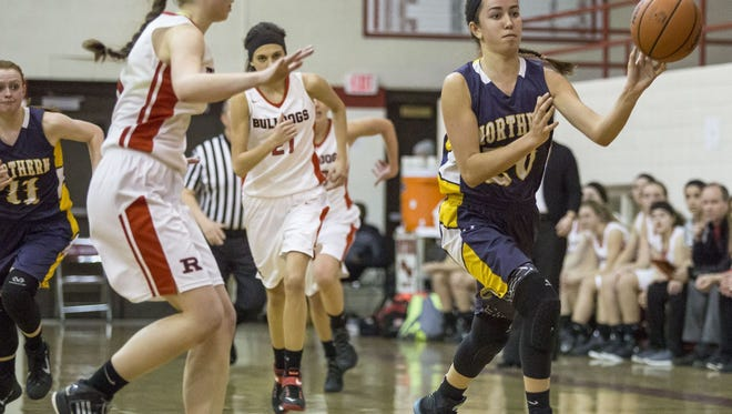 Port Huron Northern junior Jenna Koppinger passes the ball during a district final basketball game Friday, March 4, 2016 at Port Huron High School.