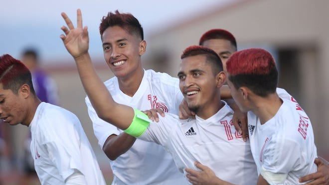 Luis Hernandez, raising hand, celebrates his goal in the second half as Desert Mirage High School beats Shadow Hills High School for the second time in two finals. The rams won 4-2 and end a perfect season.