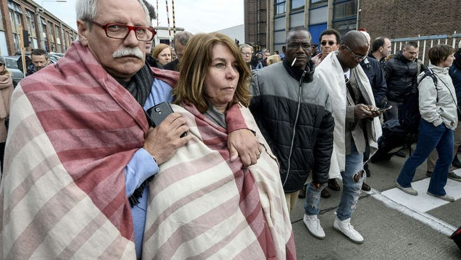 People are evacuated from Brussels airport in Zaventem on March 22 following twin blasts.