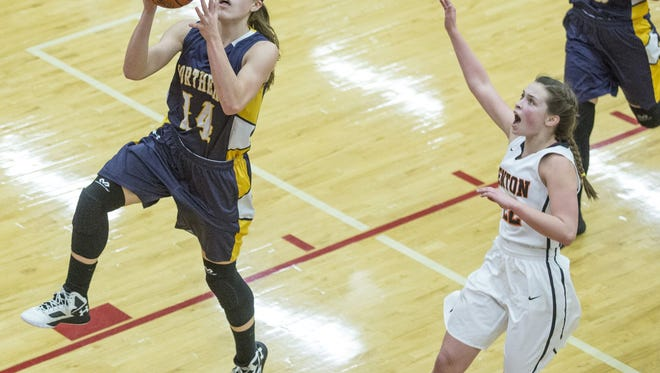 Port Huron Northern senior Kiana Votava takes a shot in front of Fenton Sophomore Maddie Carr during a regional final basketball game Thursday, March 10, 2016 at Grand Blanc High School.