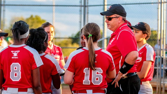 Greenville High softball coach Kevin Jones talks with his team in between innings of the Red Raiders' 8-7 win over Easley on April 12.
