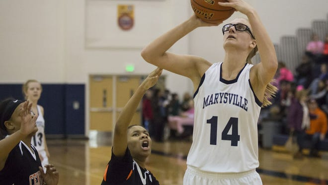 Marysville senior Payton Husson takes a shot over several Center Line defenders during a basketball game Friday, Feb. 5, 2016 at Marysville High School.