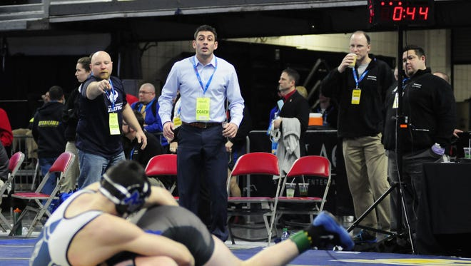 Marysville head coach Rocky Palazzolo watches on as Nino Bastianelli wrestles in the fifth place match during the individual state finals at The Palace on March 5, 2016.