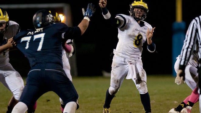 Algonac's AJ Garshott throws a pass during a football game Friday, October 16, 2015 at Richmond High School.