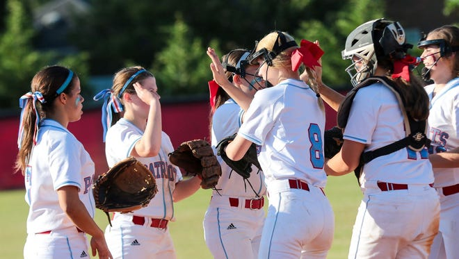 J.L. Mann's softball team, shown after the Patriots' win over Nation Ford in the district championship, began the Upper State tournament with a win over Boiling Springs.