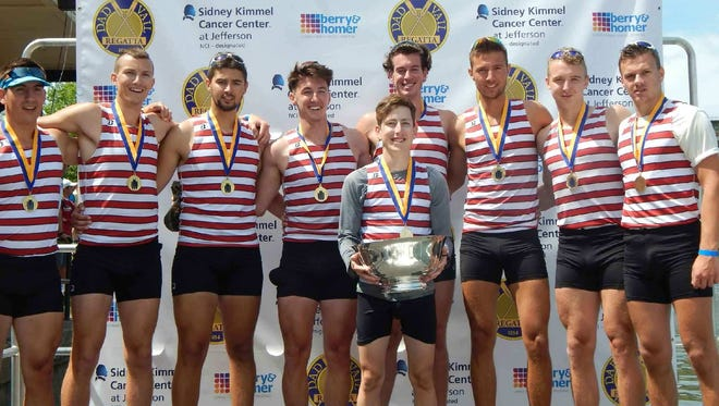 Members of the Florida Tech varsity 8 team pose with the Dad Vail Regatta trophy in Philadelphia.