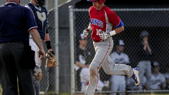 St. Clair's Ian Janssen runs home to score during a baseball game Wednesday, April 20, 2016 at Marysville High School.