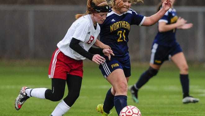 Port Huron's Erin Butler and Port Huron Northern's Makenna Fockler fight for possession during a soccer game Friday, April 29, 2016 at Port Huron Northern High School.