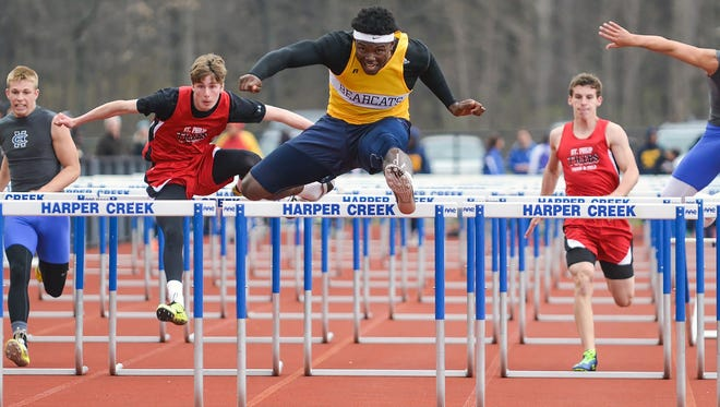 Battle Creek Central's Brandon Randle (center) will compete at the MHSAA Division 1 Track and Field Finals at Hudsonville High School on Saturday.