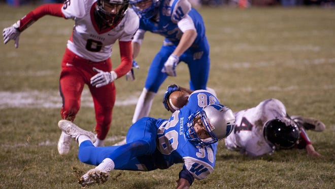 Alizhah Watson slips while carrying the ball last year against Bucyrus in Week 10. The Bucyrus and Wynford rivalry will be played in Week 2 this year.