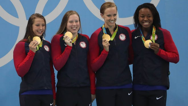 The U.S. team of Kathleen Baker, Lilly King, Dana Vollmer and Simone Manuel captured gold in the women's 4x100-meter medley relay.