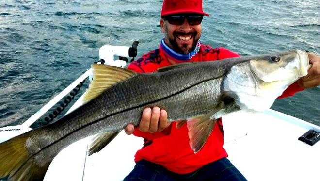 Tony Levya with a nice snook, which he caught while fishing with Capt. Chris Sommers.